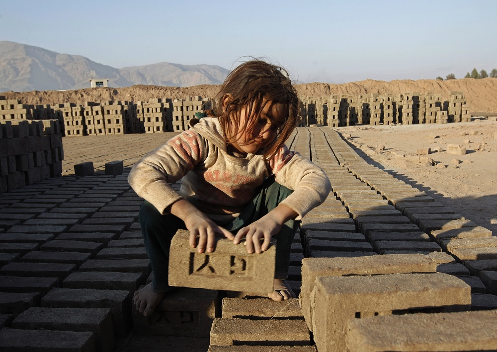An Afghan girl works at a brick-making factory in Nangarhar province January 6, 2015. — Reuters pic