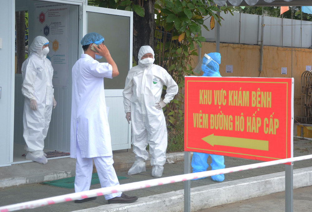 Healthcare workers wearing protective hazmat suits are seen inside the military hospital 17 amid of spread of the coronavirus disease (Covid-19) in Da Nang city, Vietnam August 4, 2020. — Reuters pic