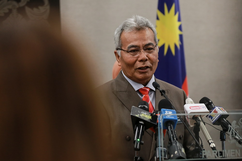Minister in the Prime Minister's Department Datuk Seri Mohd Redzuan Md Yusof speaks to reporters at the Parliament building August 10,2020. — Picture by Ahmad Zamzahuri