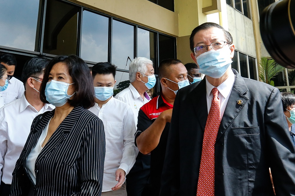 Former Penang chief minister Lim Guan Eng and his wife Betty Chew are pictured leaving the Butterworth court August 11, 2020. — Picture by Sayuti Zainudin
