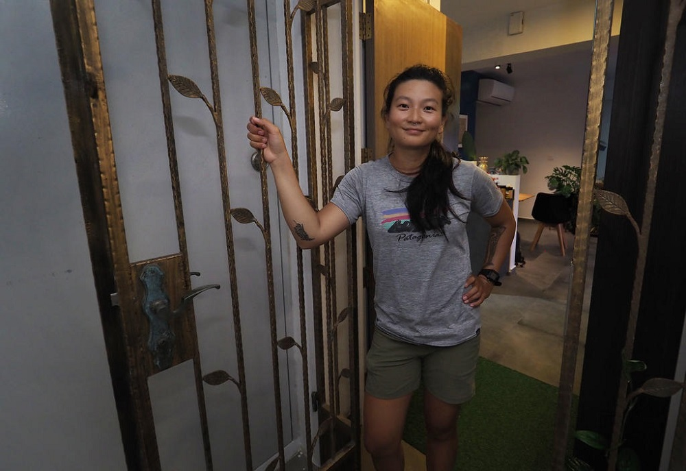 Outdoor instructor Ruby Tan, who lives in a three-room flat with her husband, housed two Malaysian workers for two months. — TODAY pic