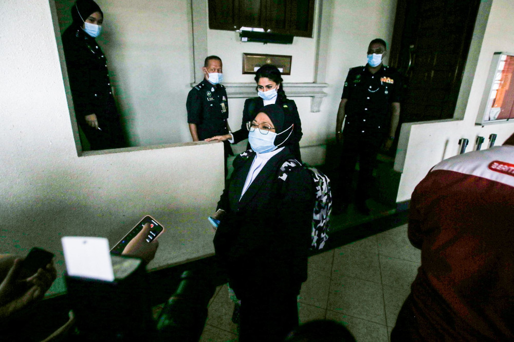 Deputy public prosecutor Julia Ibrahim speaks to reporters on August 17, 2020 outside the courtroom after a teenager was sentenced to imprisonment over the death of 23 people in a fire at Pusat Tahfiz Darul Quran Ittifaqiyah. — Picture by Hari Anggara