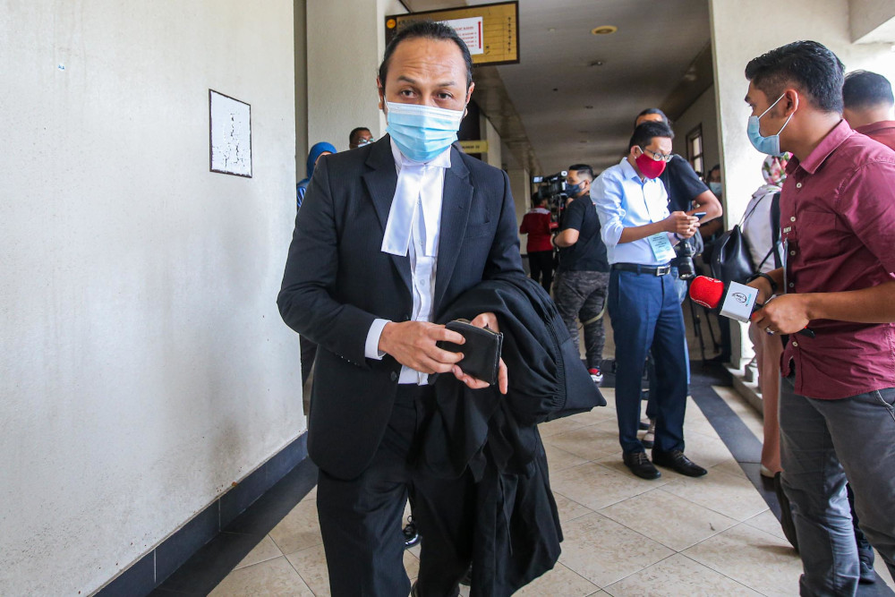 Lawyer to the teenager Mohd Haijan Omar (centre) leaves courtroom on August 17, 2020 after the teen was sentenced to imprisonment over the death of 23 people in a fire at Pusat Tahfiz Darul Quran Ittifaqiyah. — Picture by Hari Anggara