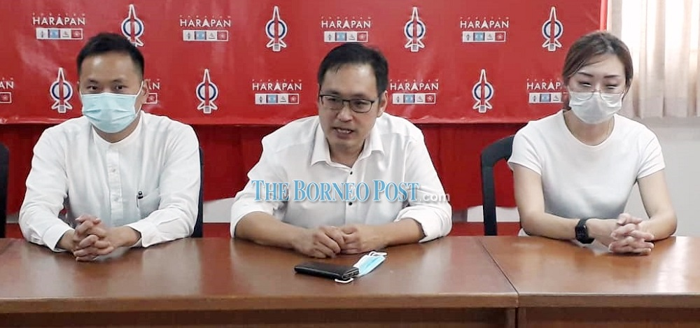 Chong, flanked by Ting (right) and his special assistant Michael Kong during the press conference at DAP headquarters. — Borneo Post Online pic
