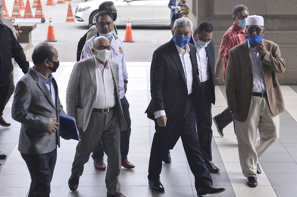 Datuk Seri Ahmad Zahid Hamidi arrives for trial at the Kuala Lumpur High Court on August 26, 2020. — Picture by Miera Zulyana