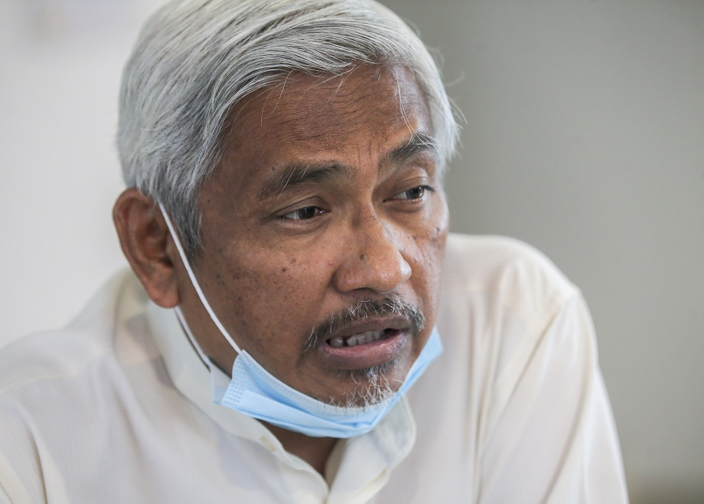 Perak Opposition Leader Abdul Aziz Bari told Malay Mail that a police report has been lodged against him over his comments about the Proclamation of Emergency. — Picture by Farhan Najib