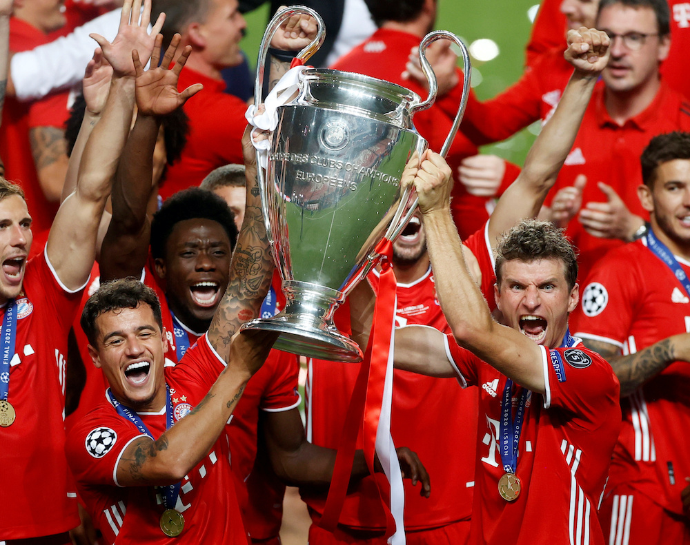 Bayern Munich's Thomas Mueller and teammates celebrate with the trophy after winning the Champions League, August 23, 2020. — Reuters pic