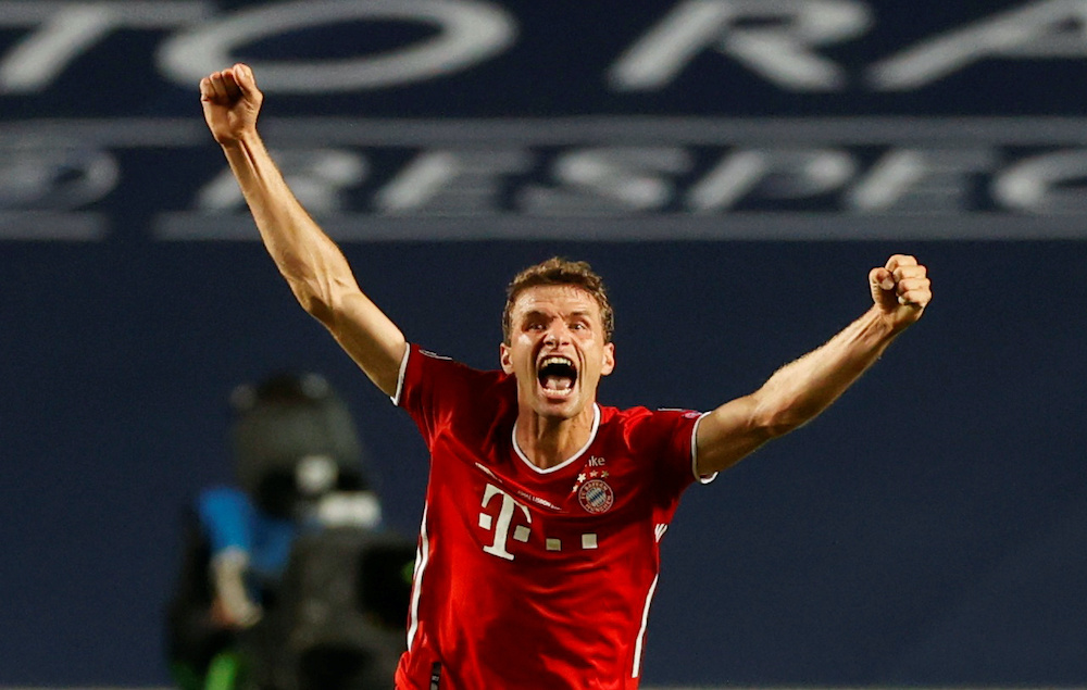 Bayern Munich's Thomas Muller celebrates after winning the Champions League, August 23, 2020. — Reuters/Matthew Childs/Pool pic
