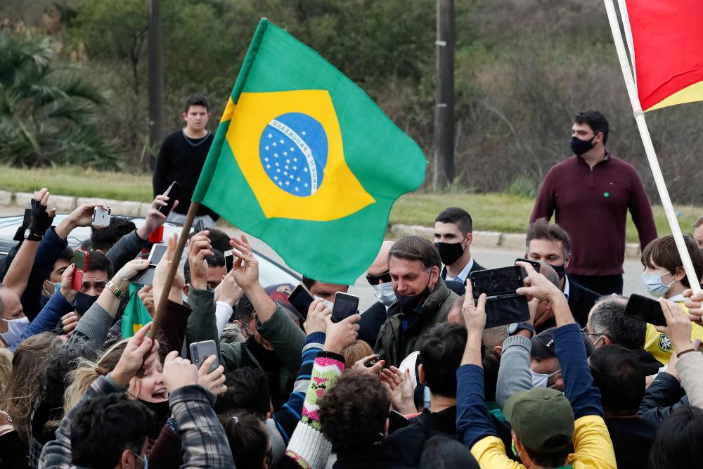 Brazil's President Jair Bolsonaro is greeted by supporters, amid the coronavirus disease outbreak, in Bage, Rio Grande do Sul state, Brazil, July 31, 2020. — Alan Santos/Brazilian Presidency handout pic via Reuters