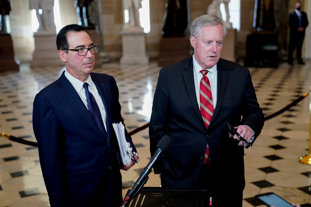 US Treasury Secretary Steven Mnuchin, left, and White House Chief of Staff Mark Meadows speak to reporters in the US Capitol in Washington, July 29, 2020. — Reuters pic