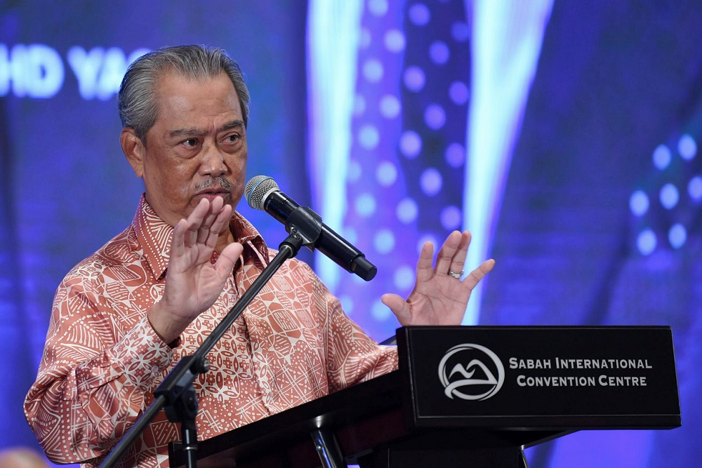 Prime Minister Tan Sri Muhyiddin Yassin delivers his speech at the Sabah International Convention Centre in Kota Kinabalu August 29, 2020. — Bernama pic