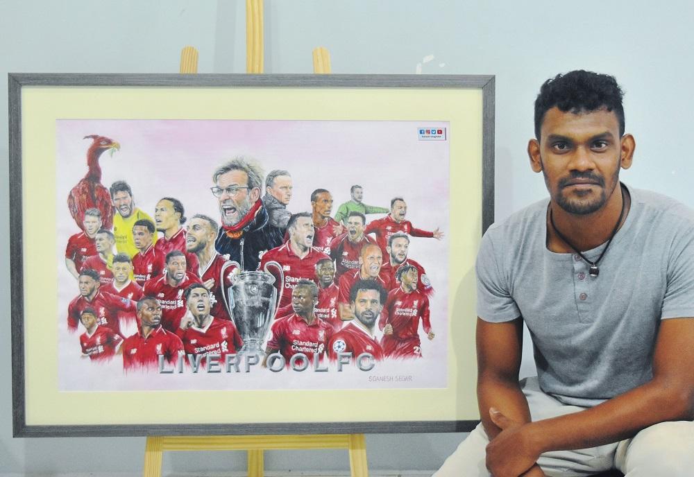 Ganeswaran Segar posing with his artwork of Liverpool Football club that took him about 11 months to complete. — Picture by Ganeswaran Segar