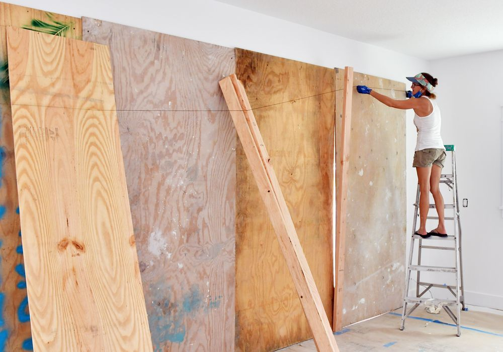 Susan Conner helps place plywood to cover the open door area of a garage under construction that has yet to have the doors installed. Scenes in Cocoa Beach as Hurricane Isaias approaches Melbourne Beach, Florida, US, August 1, 2020. — Tim Short/Florida Today via USA Network/Reuters pic