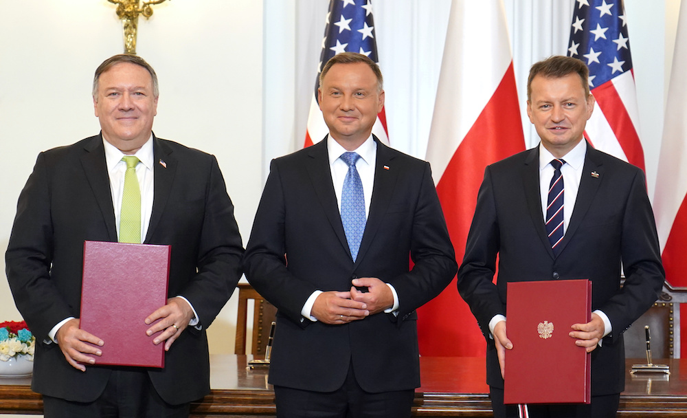US Secretary of State Mike Pompeo, Polish President Andrzej Duda and Polish Minister of Defence Mariusz Blaszczak pose for a picture after they signed the US-Poland Enhanced Defence Cooperation Agreement in the Presidential Palace in Warsaw, Poland August