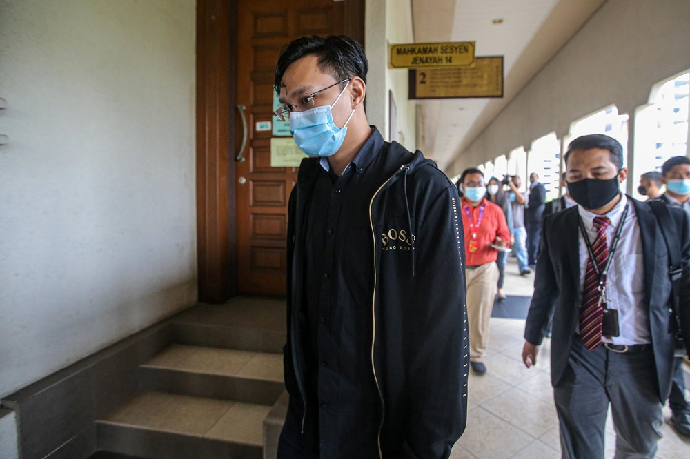 Mohd Saifullah Mohd Minggu, 30, faces 24 charges of accepting and soliciting bribes amounting to over RM3 million to secure an advertising tender under the ministry while Nurfadziana Abdul Kadir, 29, faces  a charge of abetting Mohd Saifullah in committing the offence. ― Picture by Hari Anggara