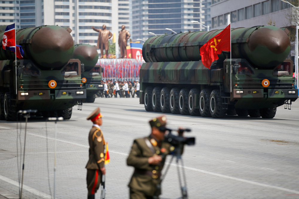 Intercontinental ballistic missiles are driven past the stand with North Korean leader Kim Jong-un during a military parade marking the 105th birth anniversary of country's founding father Kim Il-sung, in Pyongyang April 15, 2017. — Reuters pic