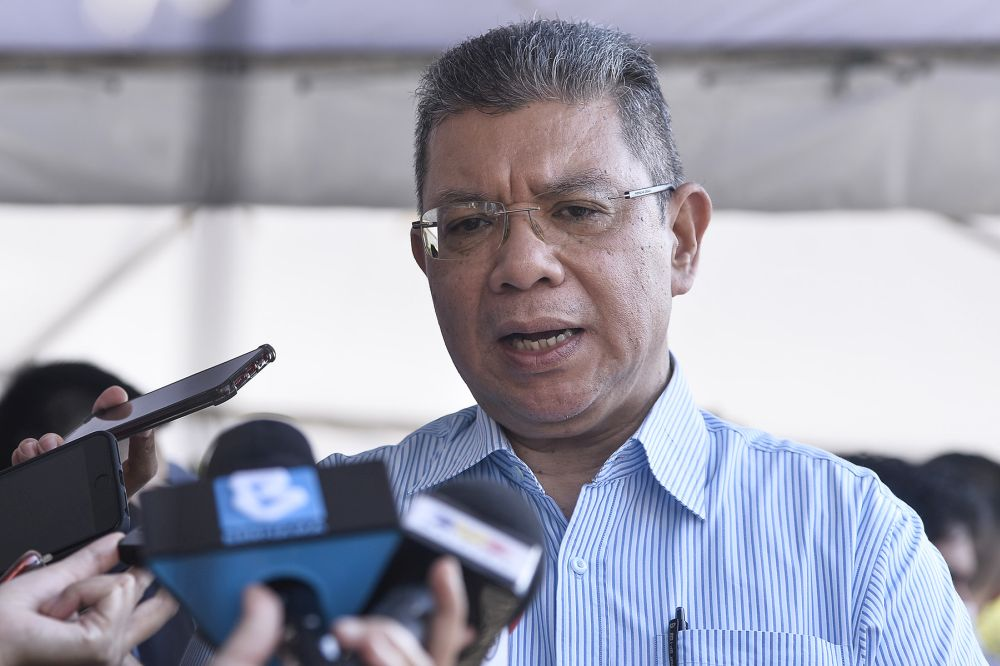Minister of Communications and Multimedia Datuk Saifuddin Abdullah addresses reporters at the launch of Oryctes' high precision agriculture spraying drone in Cyberjaya August 25, 2020. — Picture by Miera Zulyana