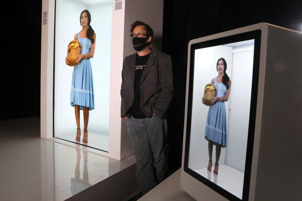 Portl inventor David Nussbaum poses for a photo next to an AI-powered life-size hologram of himself in Gardena, near Los Angeles, California, US, August 3, 2020. — Reuters pi