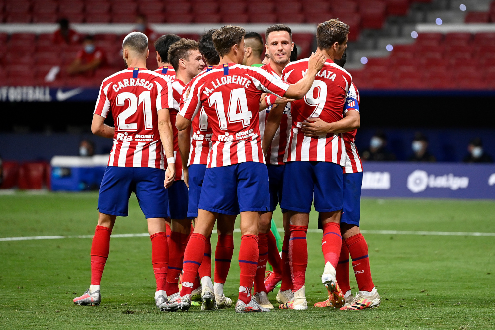 In this file photo taken July 3, 2020 Atletico Madrid's players celebrate during the Spanish League football match between Atletico Madrid and Mallorca at the Wanda Metropolitan stadium in Madrid. — AFP pic