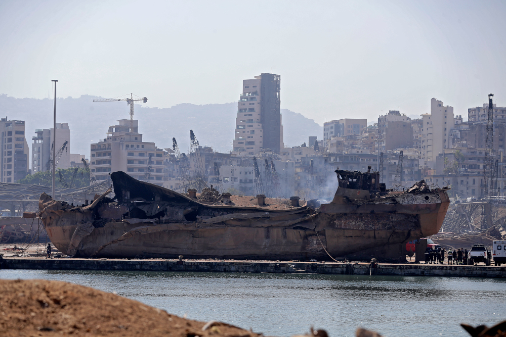 A picture shows a blown-up ship which was thrown on the land at Beirut port August 7, 2020, three days after a massive blast there shook the Lebanese capital. — AFP pic