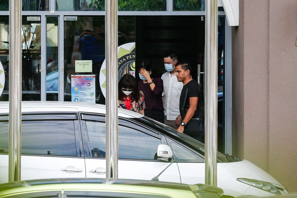 Betty Chew (second from left), wife of former finance minister Lim Guan Eng, leaves the MACC Penang branch in George Town August 7, 2020. — Picture by Sayuti Zainudin