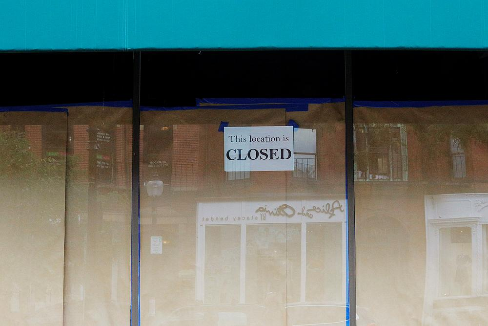 A sign reads 'This location is closed' in the papered-over windows of a storefront in Boston, Massachusetts August 5, 2020. — Reuters pic