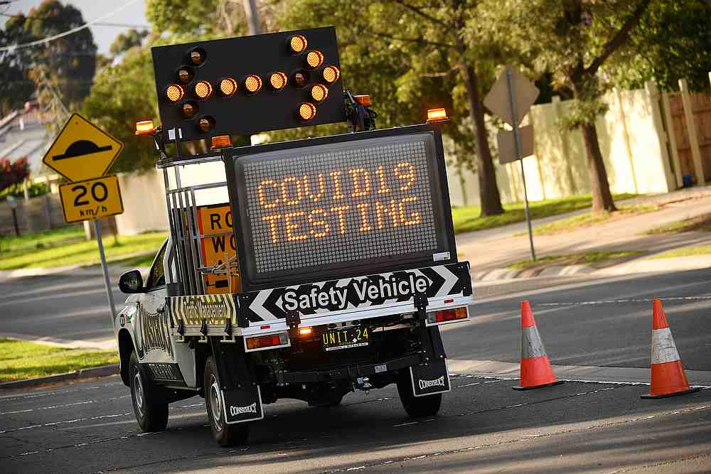 A sign points toward the entrance of a Covid-19 drive-through testing facility in Melbourne, Australia August 18, 2020. — AAP Image via Reuters