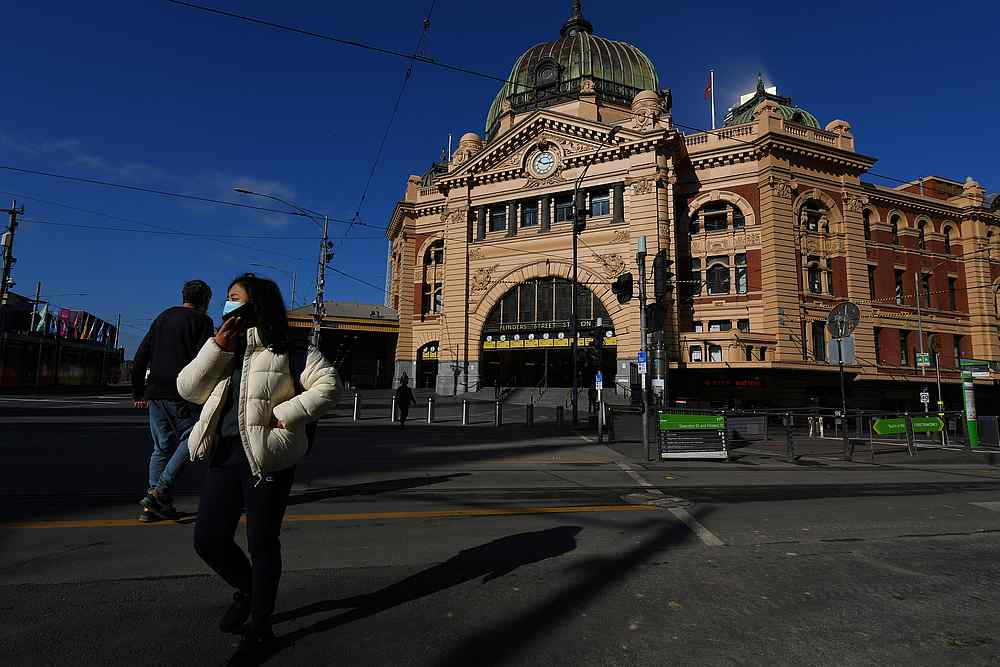A person wearing a face mask is seen outside Flinders Street Station amid the coronavirus disease in Melbourne, Australia August 10, 2020. — AAP Image via Reuters