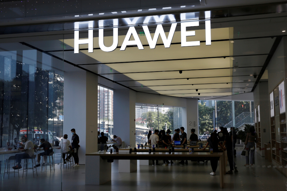 People are seen inside a Huawei store at a shopping mall in Beijing, China July 14, 2020. — Reuters pic