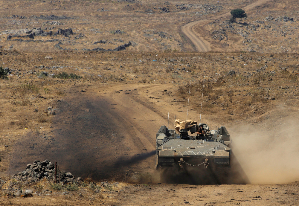 An Israeli army Namer IFV (Infantry Fighting Vehicle) drives during a drill in the Israeli-annexed Golan Heights, near Merom Golan on the border with Syria, August 3, 2020. — AFP pic