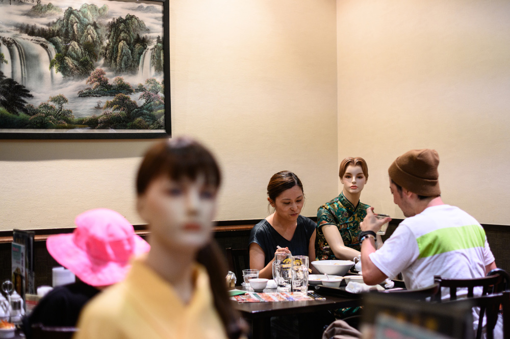 Diners eat alongside mannequins, used as a method to maintain social distancing among diners, at a restaurant in the Akabane district of Tokyo July 26, 2020, amid the Covid-19 coronavirus pandemic. — AFP pic