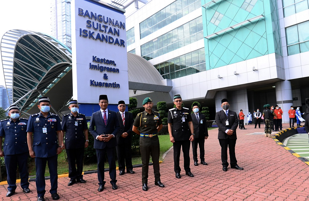 Johor Crown Prince Tunku Ismail Sultan Ibrahim (front, centre) during his visit to the Customs, Immigration and Quarantine Complex, Bangunan Sultan Ismail (BSI) in Johor Baru August 13, 2020. ― Bernama pic