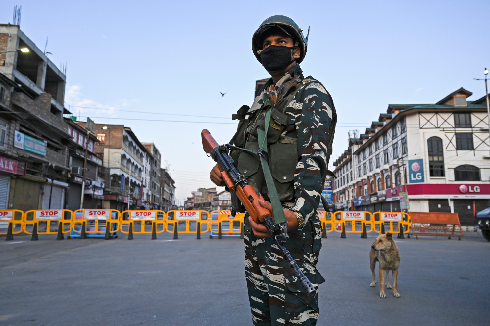 A paramilitary soldier stands guard at a checkpoint during a curfew in Srinagar on August 4, 2020. — AFP Pic