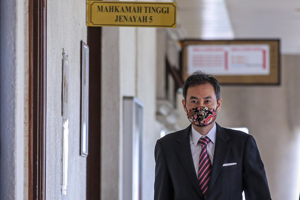 Former 1MDB CEO Datuk Shahrol Azral Ibrahim Halmi is pictured at the Kuala Lumpur Court Complex August 3, 2020. — Picture by Hari Anggara