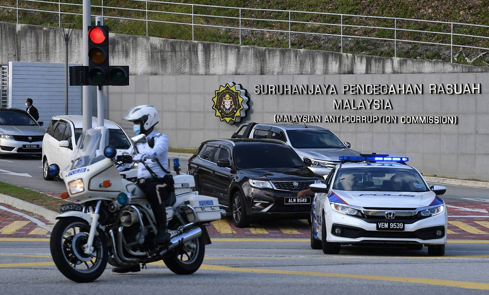 The Proton X70, with former finance minister Lim Guan Eng believed to be in it, was escorted by police patrol cars and motorcycles as it leaves the MACC headquarters in Putrajaya, August 7, 2020. ― Bernama pic