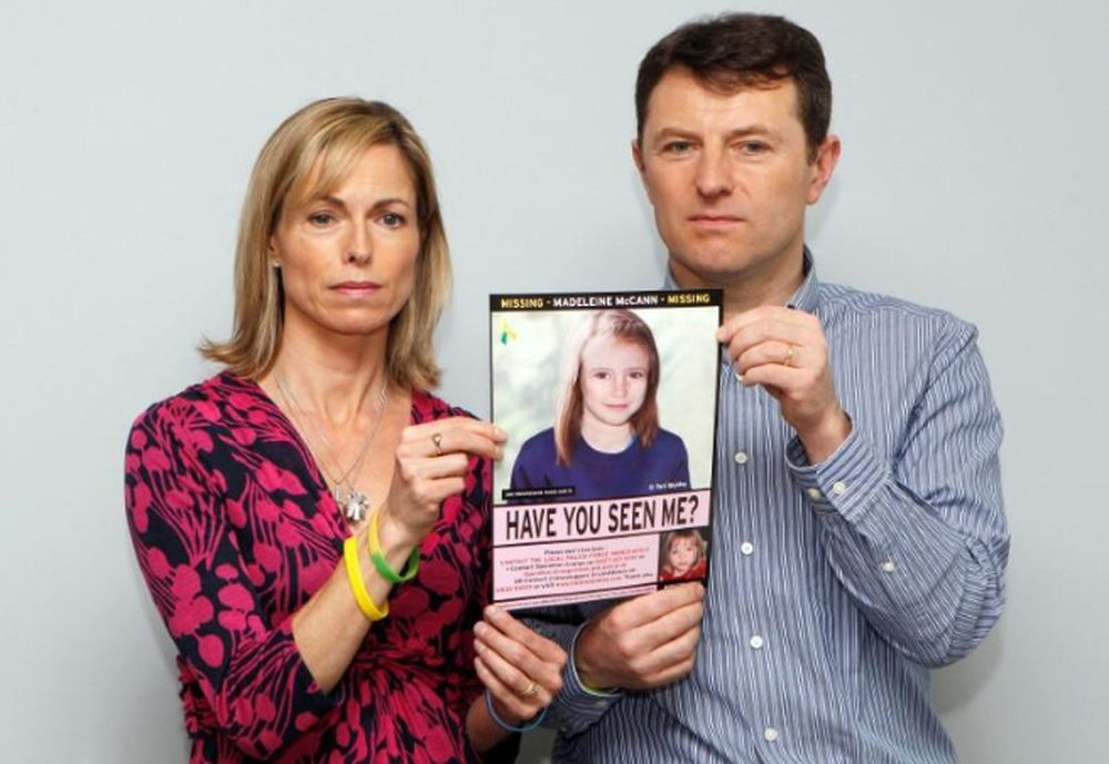 File picture shows Kate and Gerry McCaan posing with a computer-generated image of how their missing daughter Madeleine might look now, during a news conference in London, May 2, 2012. — Reuters pic