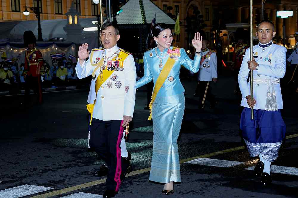 Thailand's King Maha Vajiralongkorn and Queen Suthida wave to well-wishers after a ceremony near the Grand Palace in Bangkok, Thailand, August 12, 2020. — Thailand Royal Household Bureau handout via Reuters