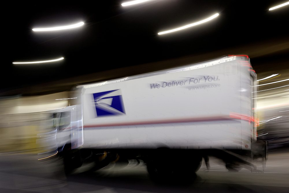 A US Postal Service (USPS) mail truck rolls into the Morgan General Mail Facility building in midtown Manhattan in New York August 13, 2020. — Reuters pic