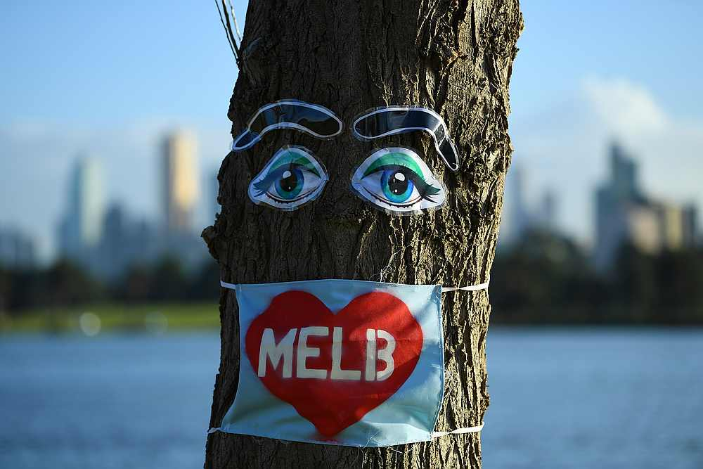 Coronavirus inspired art is seen attached to a tree near Albert Park under lockdown restrictions in Melbourne, Australia August 5, 2020. — AAP Image via Reuters