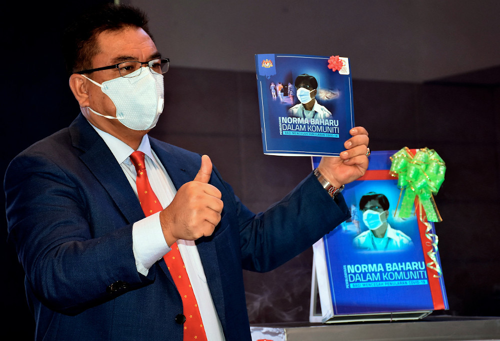 Melaka Chief Minister Datuk Sulaiman Md Ali during the launch of a book on preventing the spread of Covid-19 in Melaka, August 10, 2020. — Bernama pic