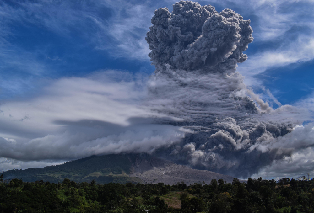 Mount Sinabung spews thick ash and smoke into the sky in Karo, North Sumatra August 10, 2020. — AFP pic