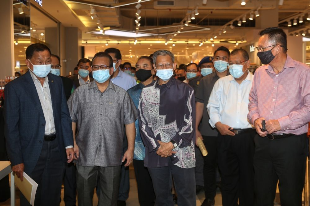 Datuk Seri Mustapa Mohamed (centre) and Datuk Alexander Nanta Linggi (second from left) are pictured during a visit to Sunway Pyramid August 18, 2020. ― Picture by Choo Choy May