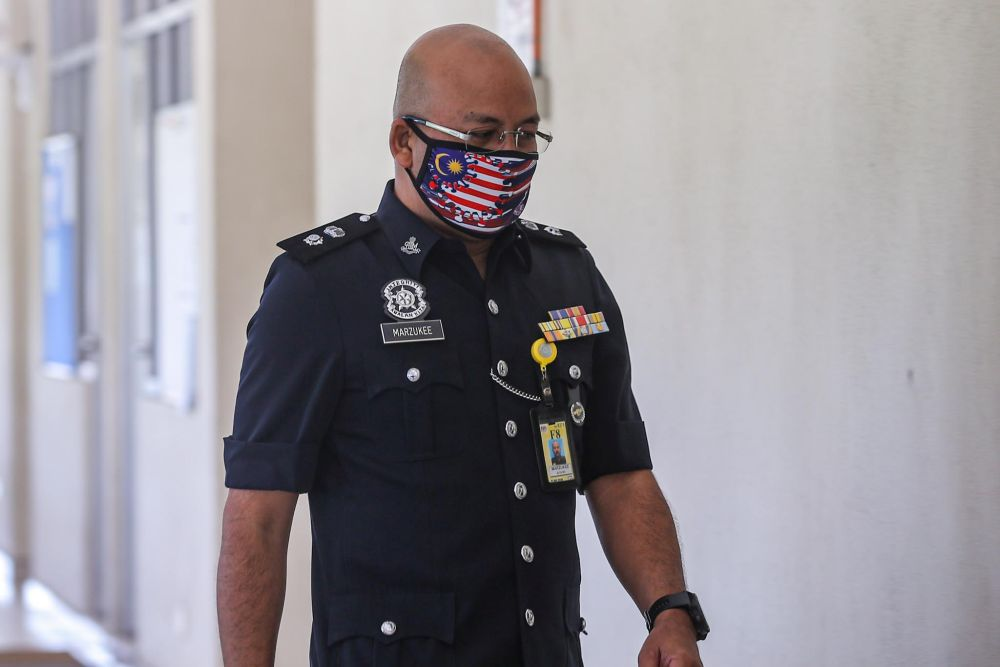 Nilai police chief Supt Mohd Marzukee Besar arrives at the Seremban Court Complex August 26, 2020. — Picture by Hari Anggara