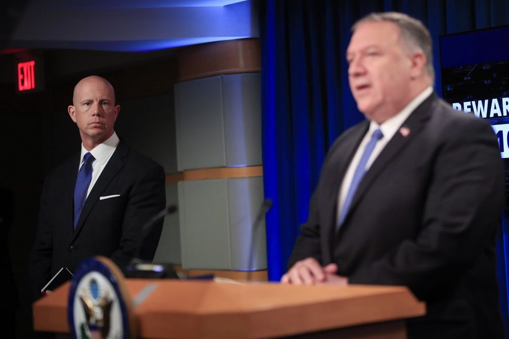 US State Department Deputy Spokesperson Cale Brown (left) listening to Secretary of State Mike Pompeo speak during a news conference at the State Department in Washington, DC, on August 5, 2020. — AFP pic