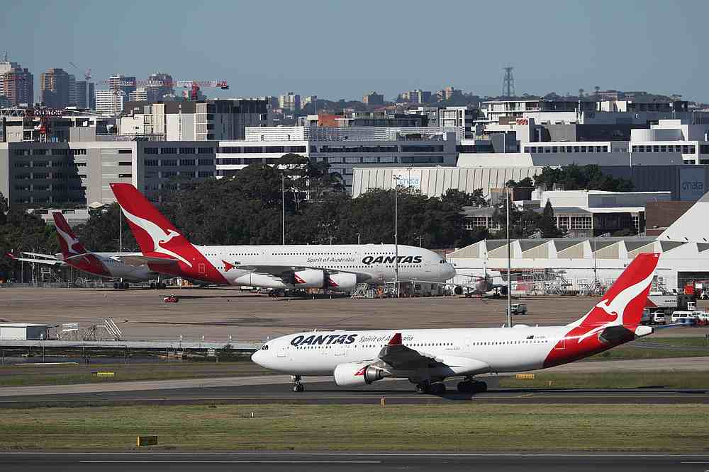 Qantas planes are seen at Kingsford Smith International Airport, following the coronavirus outbreak, in Sydney, Australia, March 18, 2020. — Reuters pic