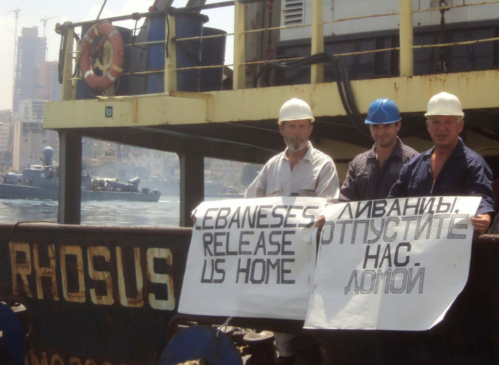 Captain Boris Prokoshev and crew members demand their release from the arrested cargo vessel Rhosus in the port of Beirut, Lebanon, in a summer 2014 photograph. — Personal archives of Boris Musinchak/Reuters pic