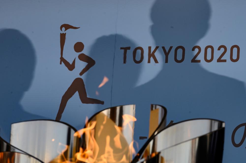 这次的东京奥运会火炬传递将一切从简,并不开放给普通观众。-法新社-