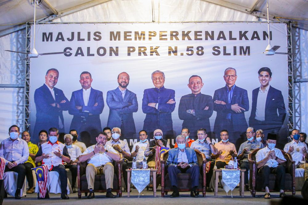 Tun Dr Mahathir Mohamad (front row, second from right) is pictured during the unveiling of Pejuang's candidate for the Slim by-election in Tanjung Malim August 12, 2020. — Picture by Hari Anggara