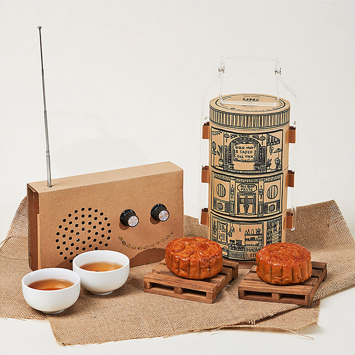 UNBOX by Huff and Puff's Tapao-Me-Home! set features tiffin carriers with hand drawn illustrations of shophouses in Ipoh. — Pictures courtesy of UNBOX by Huff and Puff