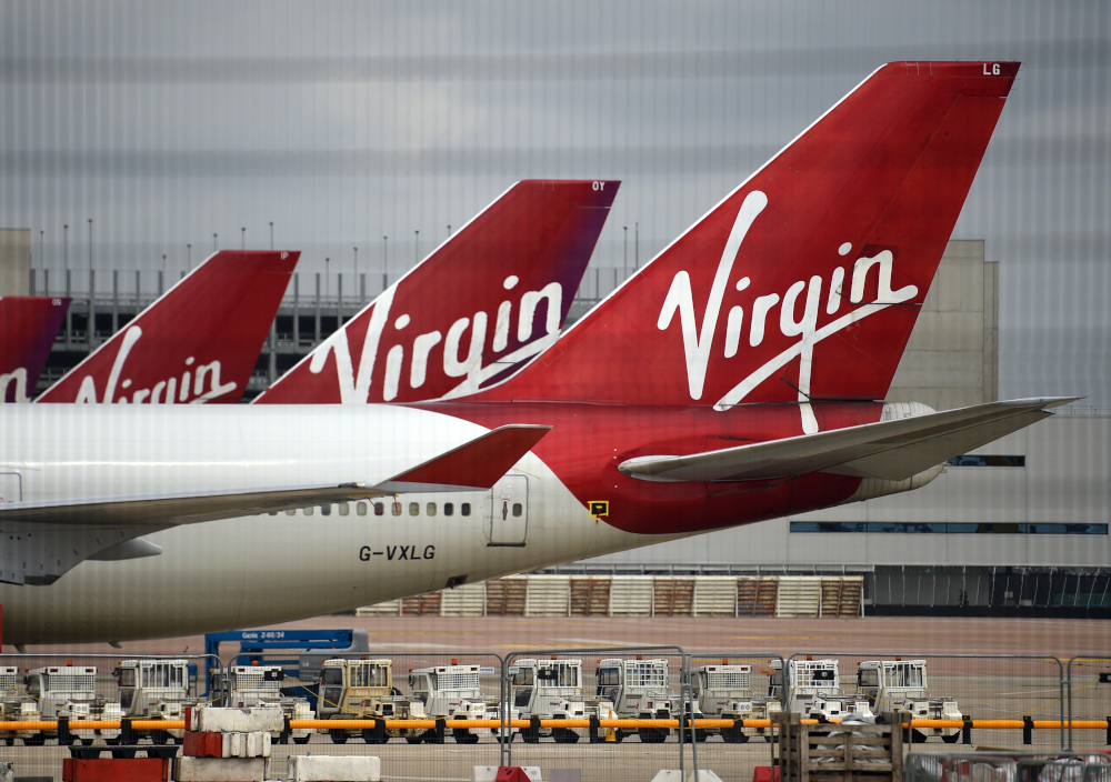 In this file photo taken June 8, 2020, Virgin Atlantic Airline planes on the apron at Manchester Airport in north-west England. — AFP pic